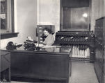 Helen Epp, RN, at the medical records desk, Immanuel Deaconess Institute