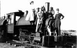 Sutton family standing on engine #5 of the C.B.&Q. Railroad near Barr, Colorado