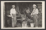 Men in blacksmith shop